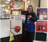 Haley Reed, an NHS member, volunteering as a Salvation Army bell ringer.